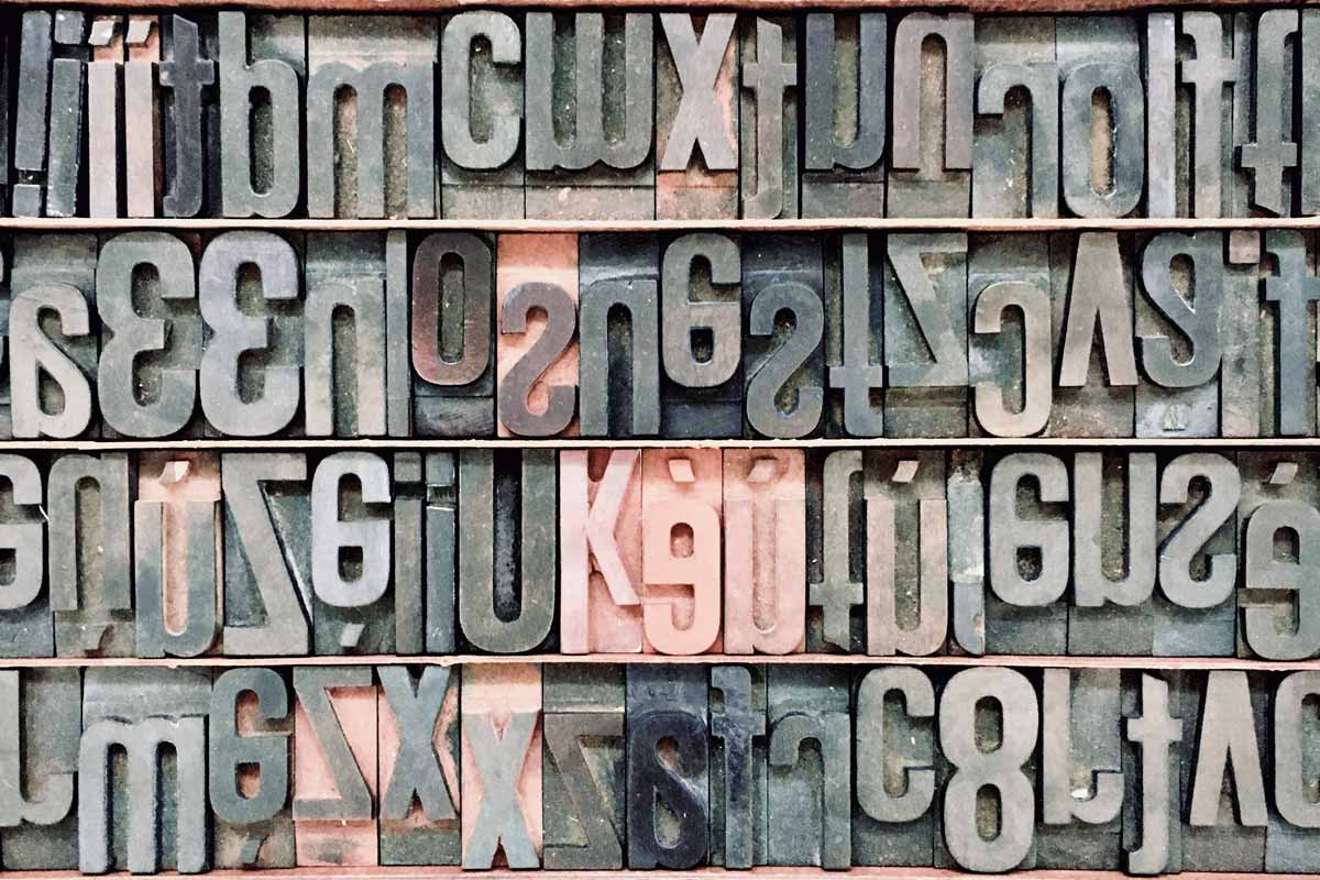 Wood type letters organized in rows.