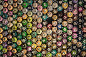 An assortment of spray paint cans.